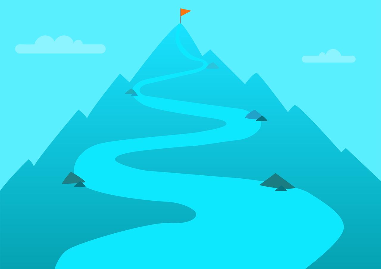 山頂にそびえたつ旗と険しい山道